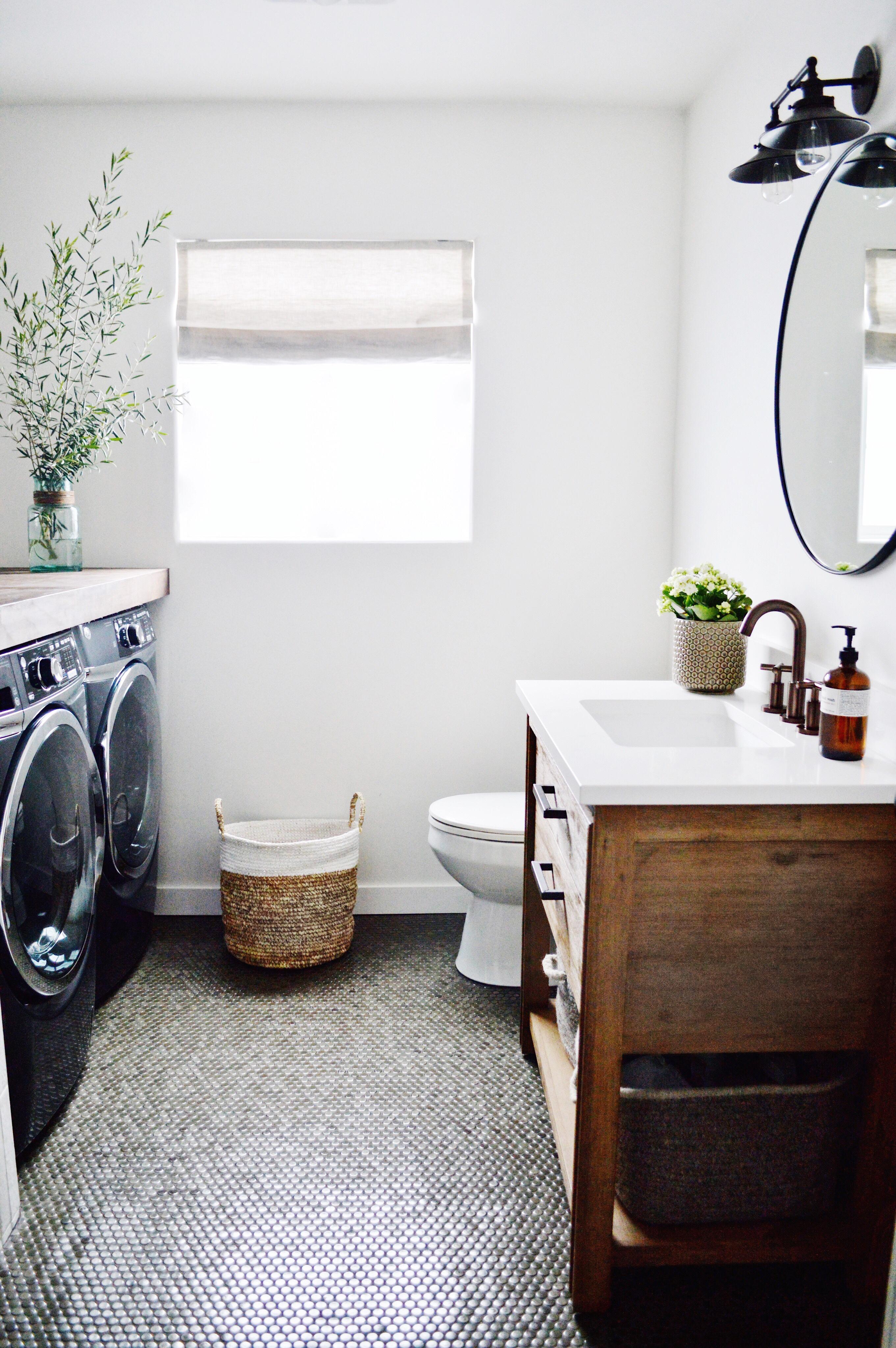 bathroom remodel: Bedrosians tile, Signature Hardware vanity, Rejuvenation mirror, RH sconce, Barn & Willow roman shade